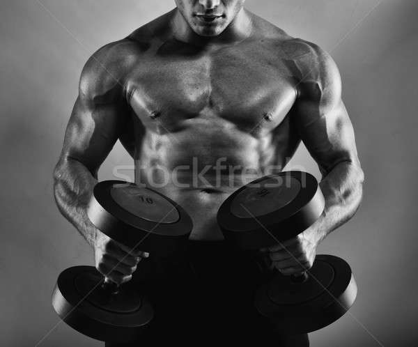 Atletisch man opleiding biceps gespierd Stockfoto © alphaspirit