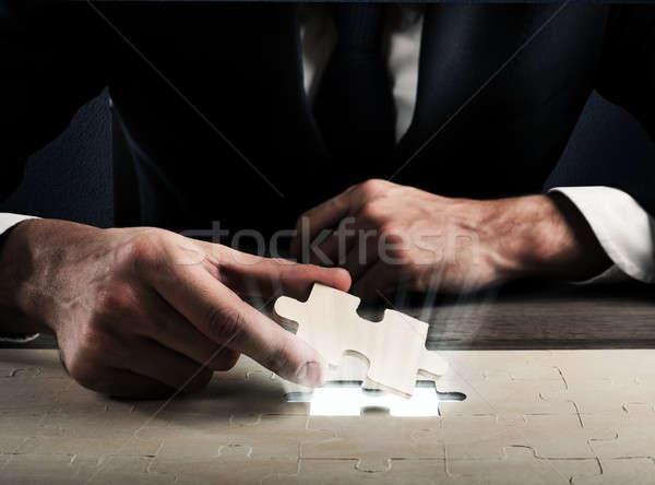Complete a puzzle Stock photo © alphaspirit