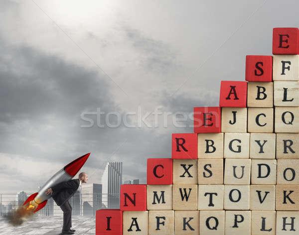 Işadamı tırmanmak başarı füze ölçek Stok fotoğraf © alphaspirit