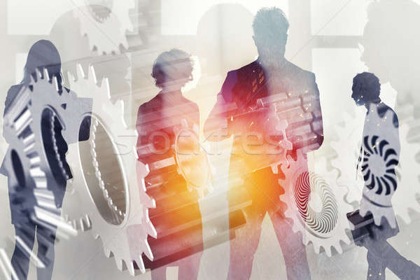 Business team with gears system. Teamwork, partnership and integration concept. double exposure Stock photo © alphaspirit