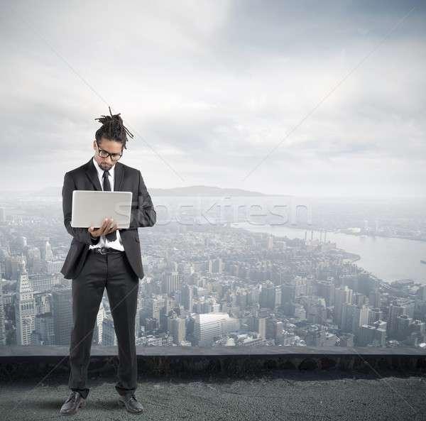 Businessman with laptop Stock photo © alphaspirit
