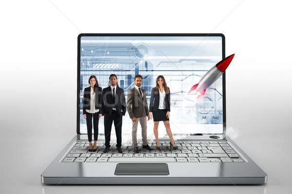 Team on a big laptop with a rocket ready to start. Concept of startup and innovation. 3D Rendering Stock photo © alphaspirit