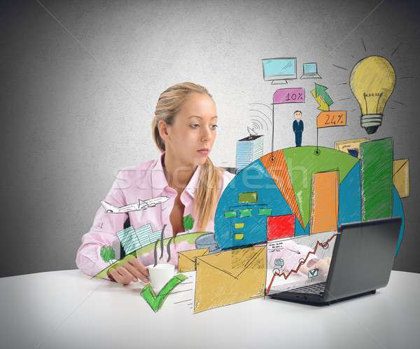 Zakenvrouw winst bedrijf business kantoor laptop Stockfoto © alphaspirit