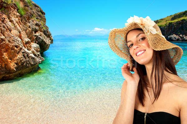 Brunette girl on the beach Stock photo © alphaspirit