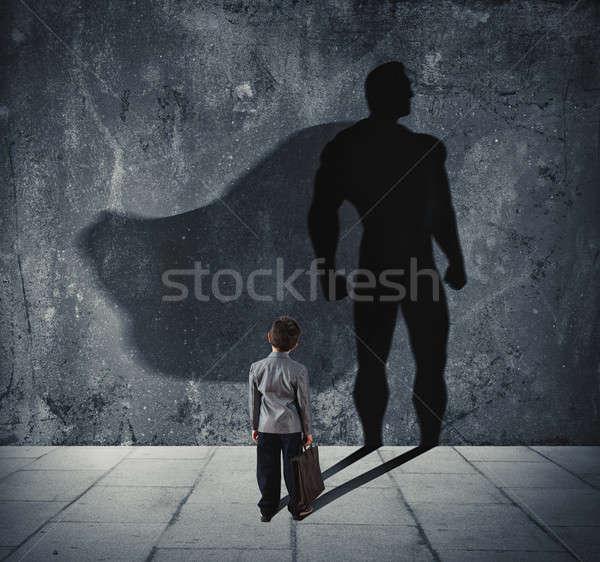 Jonge zakenman schaduw muur krachtig Stockfoto © alphaspirit