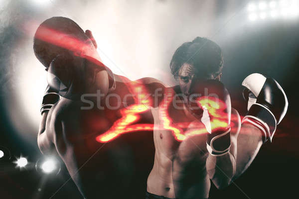 Boxer in a boxe competition beats his opponent Stock photo © alphaspirit