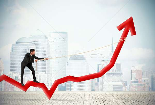 Zakenman corporate winst Rood business vrouw Stockfoto © alphaspirit