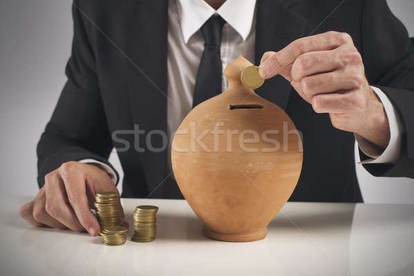 Tasarruf işadamı para kumbara iş Stok fotoğraf © alphaspirit