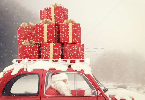 Santa Claus on a red car full of Christmas present Stock photo © alphaspirit
