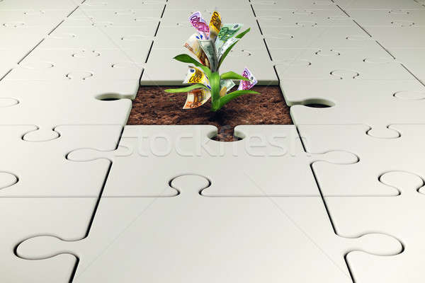 Plant with money grows from a missing piece of puzzle Stock photo © alphaspirit