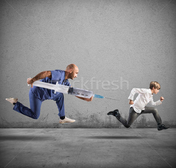 Fear of the vaccine concept with running child Stock photo © alphaspirit