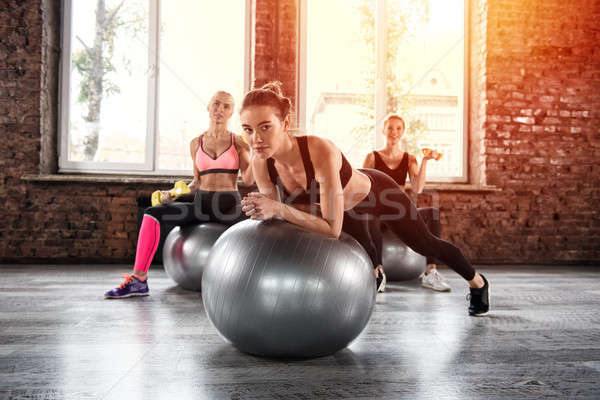Girls working out at a gym with the gymball Stock photo © alphaspirit