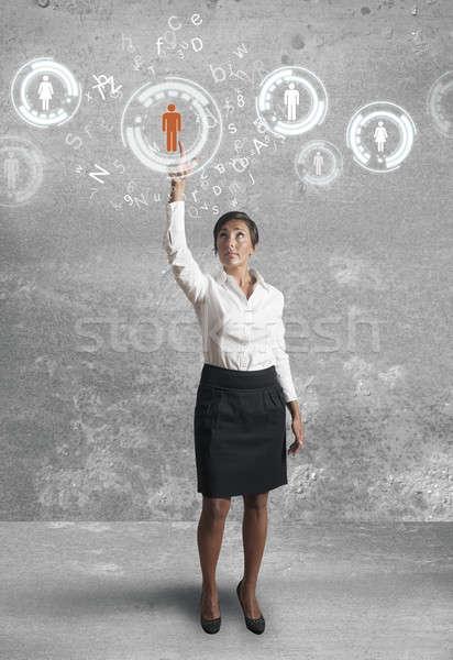 Businesswoman works with social network Stock photo © alphaspirit