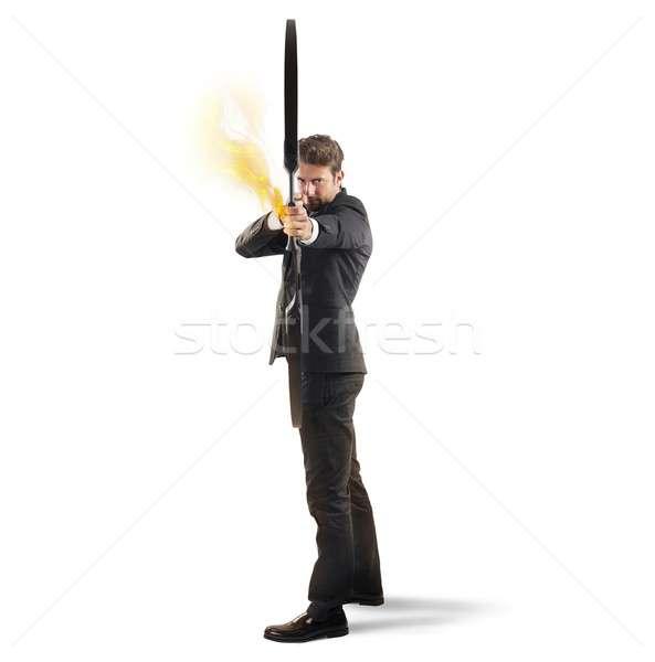 Determinated businessman with bow Stock photo © alphaspirit