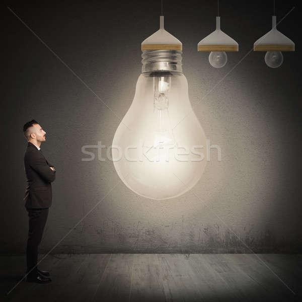 Nagy ötlet üzletember külső villanykörte férfi Stock fotó © alphaspirit