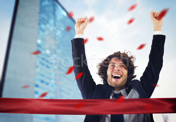 Successful victorious businessman Stock photo © alphaspirit