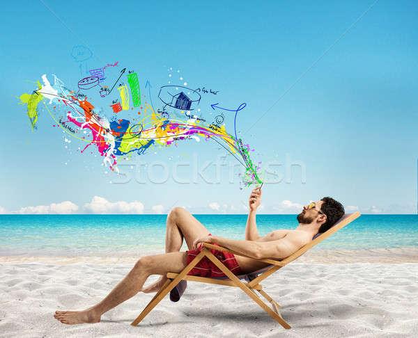Empresário espreguiçadeira telefone móvel praia telefone Foto stock © alphaspirit