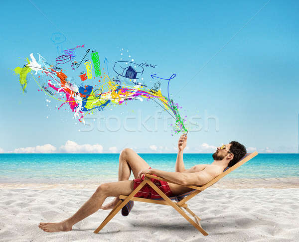 Zakenman ligstoel mobiele telefoon strand telefoon Stockfoto © alphaspirit
