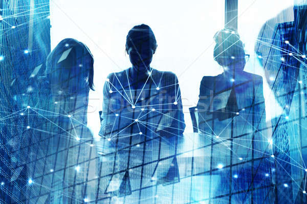Silhouette of businessperson in office with network effect. concept of partnership and teamwork Stock photo © alphaspirit