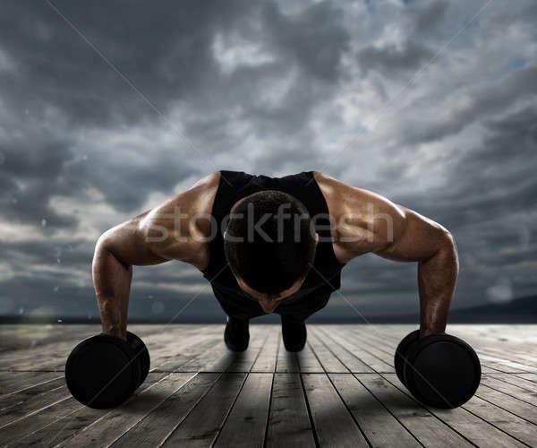Man doing pushups outdoor Stock photo © alphaspirit