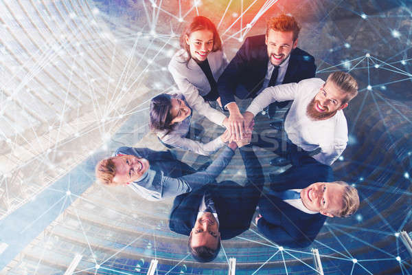 Business people putting their hands together with internet network effects. Concept of integration,  Stock photo © alphaspirit