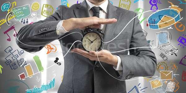 Время-деньги бизнесмен часы бизнеса служба технологий Сток-фото © alphaspirit