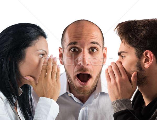 Parlando segreto Coppia uomo parlare orecchio Foto d'archivio © alphaspirit
