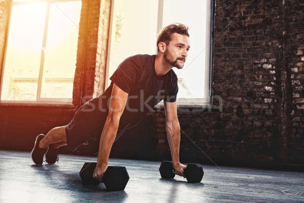 Man doing pushups at the gym Stock photo © alphaspirit