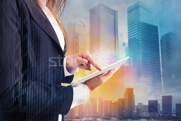 Businesswoman shares document with tablet. Internet concept Stock photo © alphaspirit