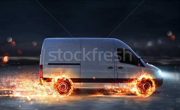 Super fast delivery of package service with van with wheels on fire Stock photo © alphaspirit