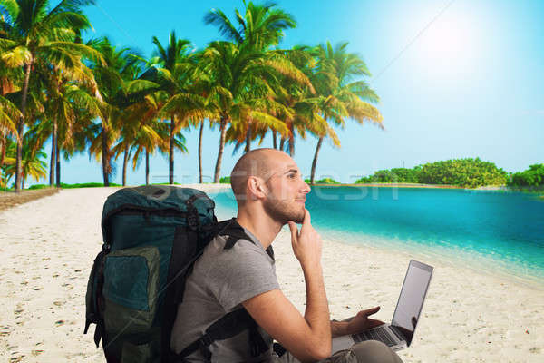 Explorer plans a new travel to a tropical beach with his laptop Stock photo © alphaspirit