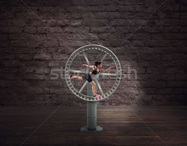 Athletic woman runs in a looping wheel. concept of sport routine Stock photo © alphaspirit