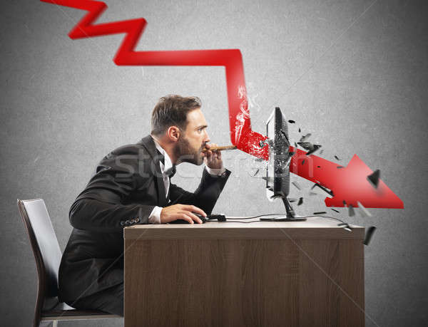 Businessman look the negative report of his company. A red arrow breaks the screen Stock photo © alphaspirit