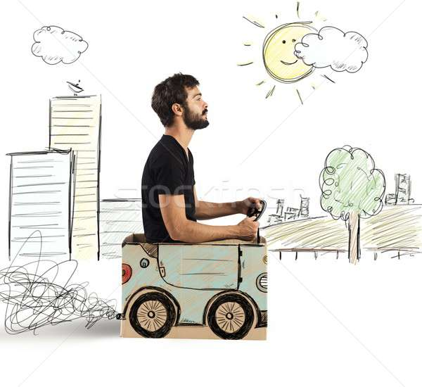 Cardboard car in drawing city Stock photo © alphaspirit