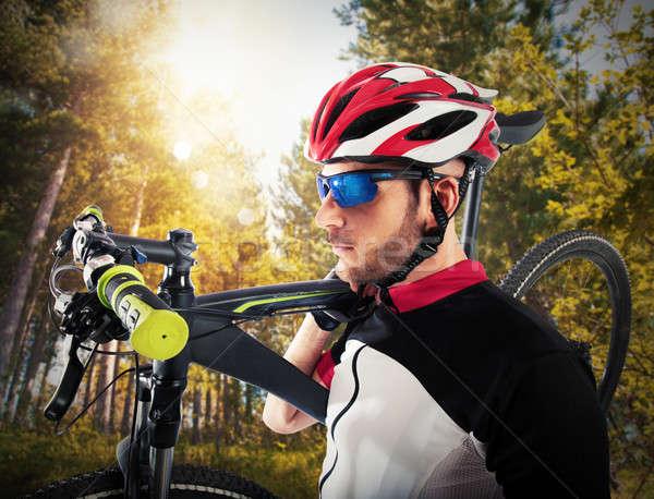 Kerékpáros hegyi kerékpár férfi sport naplemente természet Stock fotó © alphaspirit