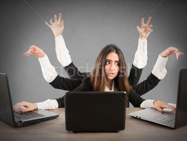 Stock photo: Multitasking secretary