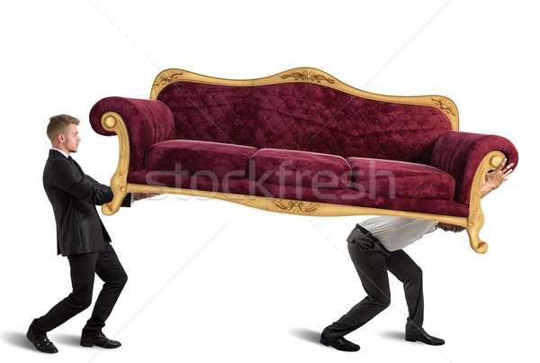 Men carrying a sofa Stock photo © alphaspirit