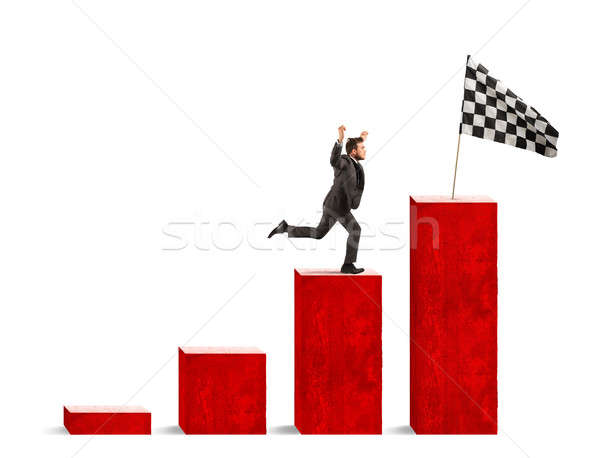 Businessman reaches glory on a statistical scale Stock photo © alphaspirit