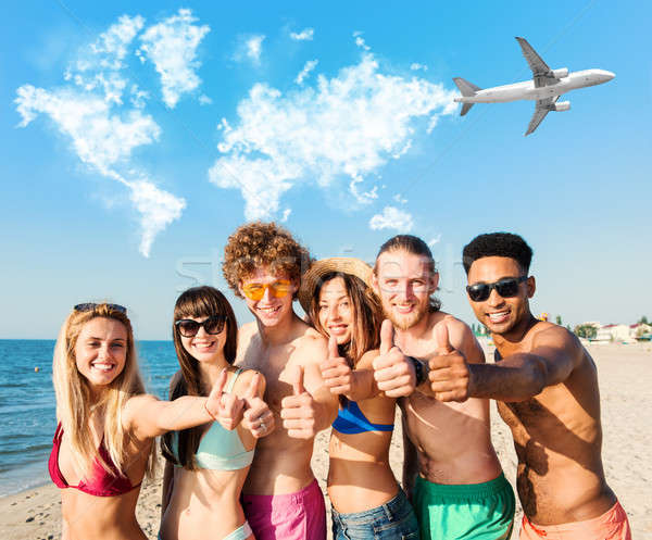 Group of friends having fun on the beach. Concept of summertime Stock photo © alphaspirit