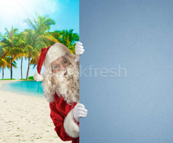 Santa Claus on a tropical beach with a blank space for your text Stock photo © alphaspirit