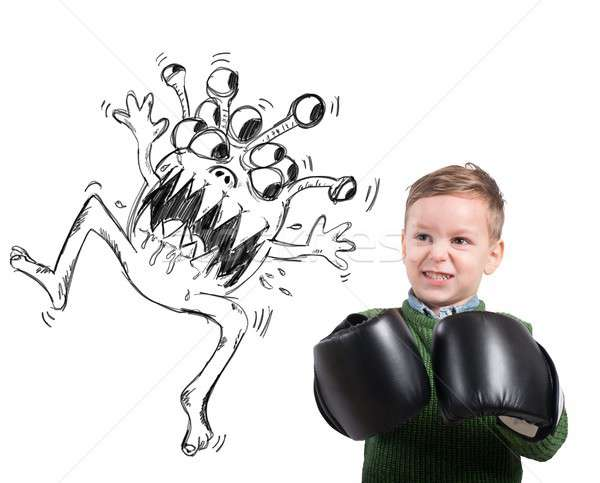 Stock photo: Child faces a virus