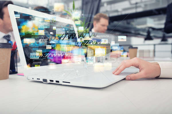 Businesswoman shares online document with a fast internet connection Stock photo © alphaspirit