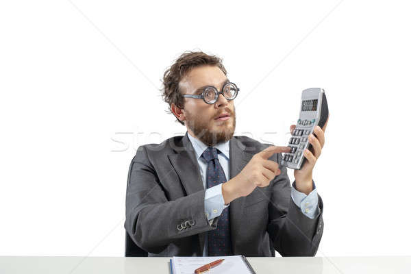 Nerd accountant does calculation of company revenue Stock photo © alphaspirit