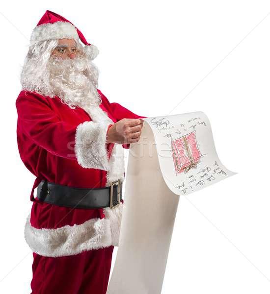 Santa Claus with gifts list Stock photo © alphaspirit