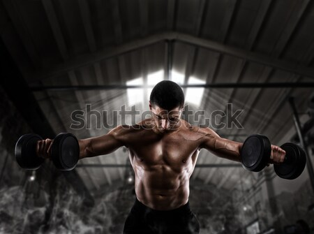 Physique of a man with muscles Stock photo © alphaspirit