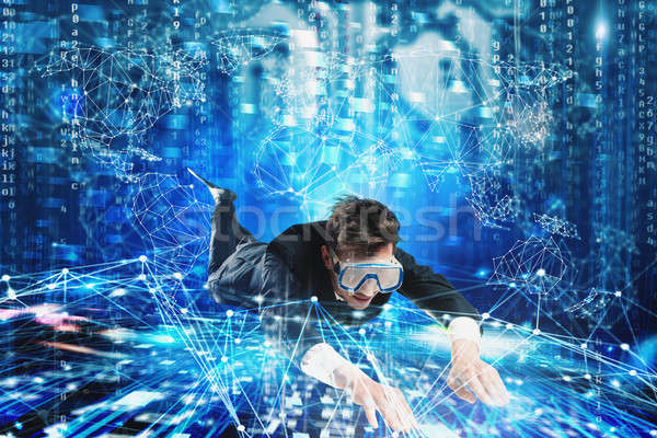 Businessman surfing the internet underwater with mask. Internet exploration concept Stock photo © alphaspirit