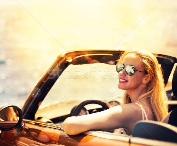 Genç kadın kabriyole araba deniz genç kafkas Stok fotoğraf © alphaspirit