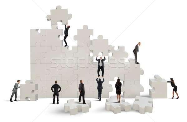 Equipe de negócios trabalhando construir quebra-cabeça mulheres fundo Foto stock © alphaspirit