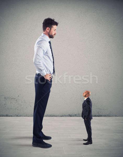 небольшой бизнесмен испуганный большой Boss служба Сток-фото © alphaspirit