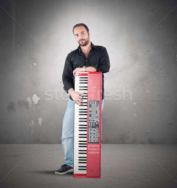 Musician and piano Stock photo © alphaspirit